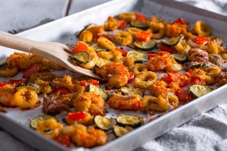 Calamari e gamberi gratinati con verdure