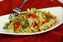 Ricetta Fusilloni piselli, gamberetti e pomodorini