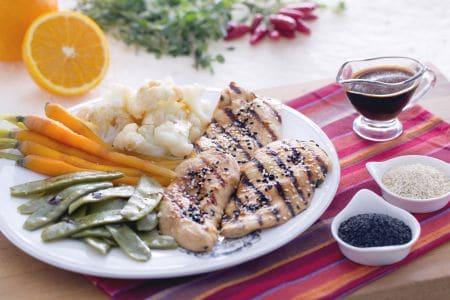 Pollo in salsa di soia con verdure al vapore