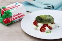 Caprese di stracchino e pomodori confit con cialda al basilico