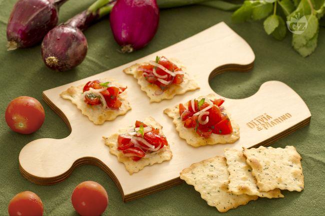 Sfoglie alle olive con cipolle e pomodorini