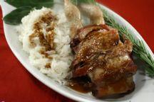 Quaglie con mantello di pancetta e riso